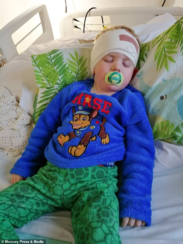 Jack, from Sheffield, South Yorkshire, was diagnosed with a diffuse intrinsic pontine glioma (DIPG) - an aggressive brain tumour with low survival rates (pictured after an operation)